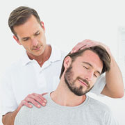 Chiropractic patient receiving a neck adjustment